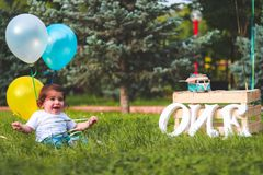 Girl Holding Blue and Yellow Balloons royalty free stock images