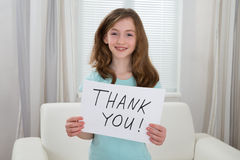 Girl Holding Board With The Text Thank You Royalty Free Stock Image