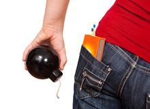 Girl holding bomb. Dangerous girl, holding a bomb in hand and carrying matches in the back pocket Royalty Free Stock Photos