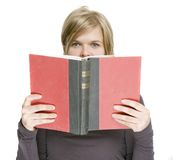 A girl is holding a book Royalty Free Stock Images