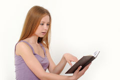 Girl holding book Stock Image