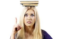 Girl holding book on head Stock Photography