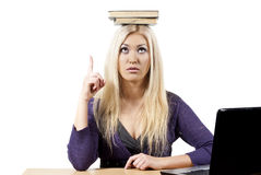 Girl holding book on head Stock Photo