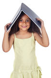 Girl holding book on head Royalty Free Stock Images