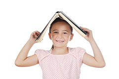 Girl holding book on head royalty free stock photo