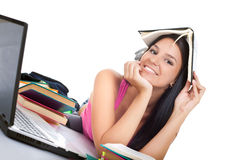 Girl holding book on her head, Royalty Free Stock Photos