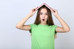 Girl holding book on her head royalty free stock photo