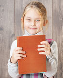 Girl holding a book Royalty Free Stock Image