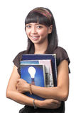 Girl holding book over white background Stock Image