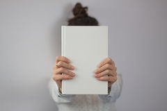 Girl holding book stock images