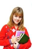 Girl holding books. Pretty teen girl holding books over white Royalty Free Stock Photography