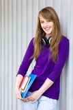 Girl holding books Stock Photos