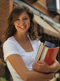 Girl Holding Books Royalty Free Stock Photos