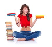 Girl holding books Stock Images
