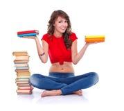 Girl holding books Stock Images