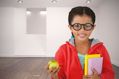 Composite image of girl holding books and apple Royalty Free Stock Photography