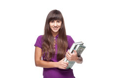 Girl holding books. Caucasian casual smiling girl holding books isolated on white Stock Photography