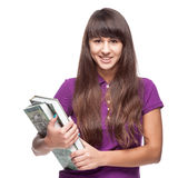 Girl holding books. Caucasian casual smiling girl holding books isolated on white Stock Image