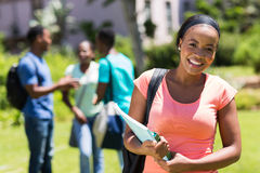 Girl holding books. Happy young African American college girl holding books Stock Photography