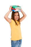 Girl holding books isolated on white background Stock Photos