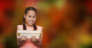 Girl holding books over blur background Stock Images