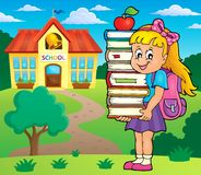 Girl holding books theme image 2 Royalty Free Stock Photography