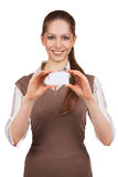 Girl holding in both hands a plastic card Stock Photo