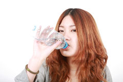 Girl holding with bottle of water Royalty Free Stock Photography