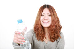 Girl holding with bottle of water Royalty Free Stock Images