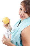 Girl holding bottle of water and apple Royalty Free Stock Photo