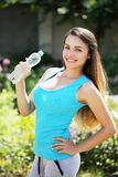 Girl holding a bottle of water Stock Image