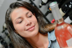 Girl holding bottle wine Royalty Free Stock Photo