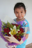 Girl holding bouquet. Girl smiling & holding bouquet of red roses Stock Images