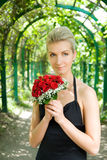 Girl holding bouquet Royalty Free Stock Image