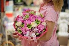 Girl holding a bouquet consisting of pink peonies and white ranunculuses Stock Images