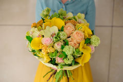 Girl holding Bouquet of the different mixed orange flowers Stock Image