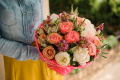 Girl holding Bouquet of the different mixed orange and white flowers Royalty Free Stock Photo
