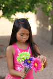 Girl Holding Bouquet of Flowers Stock Image