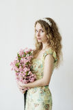 Girl holding a bouquet of flowers stock images