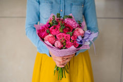 Girl holding bouquet of a mixed pink and purple flowers Royalty Free Stock Photos