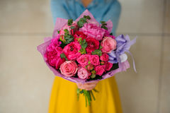 Girl holding bouquet of a mixed pink and purple flowers Stock Images