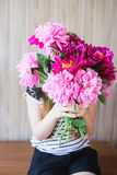 Girl holding a bouquet of peonies Royalty Free Stock Photo