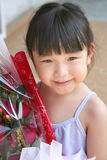 Girl holding bouquet of roses. Girl smiling & holding bouquet of red roses royalty free stock photos