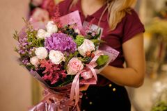 Girl holding a bouquet of roses, astilba and berries royalty free stock photos