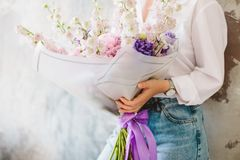The girl is holding a bouquet of summer flowers Stock Photos