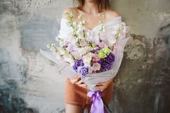 The girl is holding a bouquet of summer flowers Stock Photo