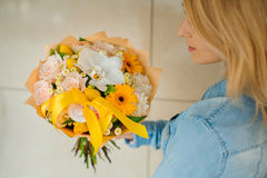 Girl holding a bouquet of white flowers stock photography
