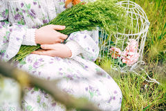 girl holding a bouquet of wildflowers Stock Photos