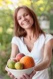 Girl holding a bowl of fruits Stock Photography