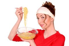 Girl holding a bowl of pasta. Advertising stock image